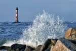 The Morris Island Lighthouse with a giant wave splash on the groin!
