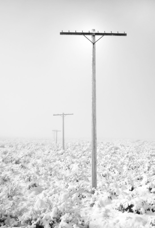 Old Rt. 66.  A hint of sun behind the top of the first telephone pole.  720nm IR