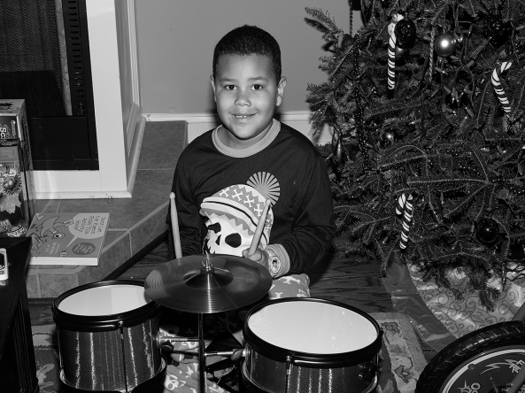 Jordan, my grandson on his new Christmas drum set taken with the Monochrome and the  Leica SF 58
